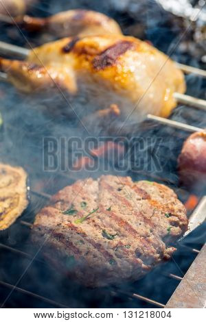 Grill. Quail on the grill. Grill pork meat. Grill burgers. Grill vegetables. Grill skewer.