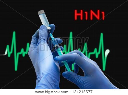 Treatment of h1n1 (swine flu). Syringe is filled with injection. Syringe and vaccine. Medical concept.