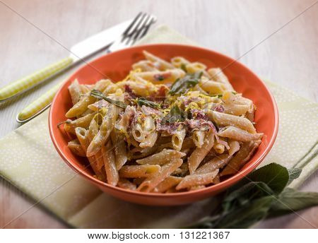 pasta with speck sage and cream sauce, selective focus