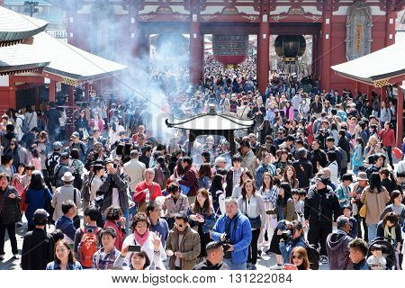 TOKYO, JAPAN - MARCH 29, 2016 : unidentified people visit sensoji temple in Tokyo on 29 March 2016.. Sensoji temple is the most famous attraction in Asakusa, Tokyo, Japan