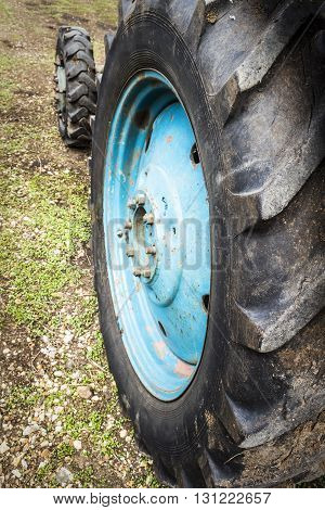 Wheels agricultural tractor standing in the backyard