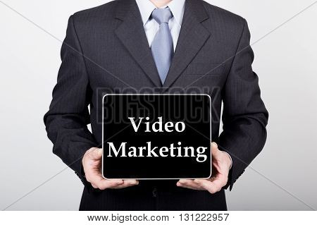 technology, internet and networking in business concept - businessman holding a tablet pc with video marketing sign. Internet technologies in business.