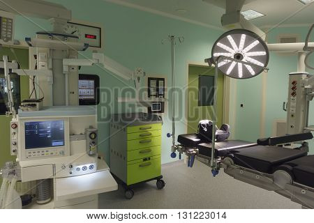 Operating room in modern clinic with equipment and medical devices