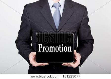 technology, internet and networking in business concept - businessman holding a tablet pc with promption sign. Internet technologies in business.