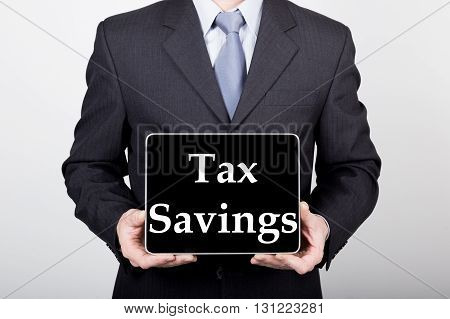 technology, internet and networking in business concept - businessman holding a tablet pc with tax savings sign. Internet technologies in business.