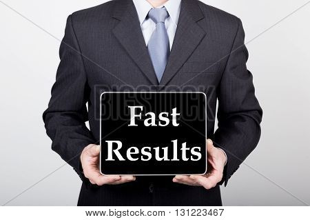 technology, internet and networking in business concept - businessman holding a tablet pc with fast results sign. Internet technologies in business.