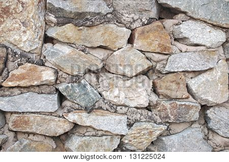 Natural Stone wall suck with concrete for background