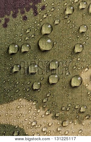 Waterproof textile fabric with rain drops, close up