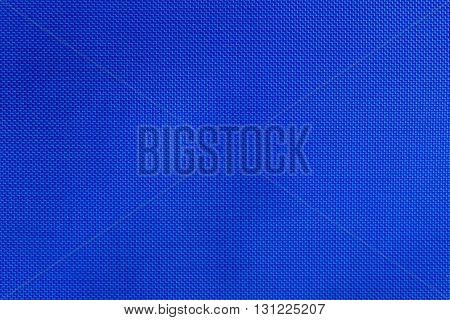 Blue nylon fabric texture background, copy space