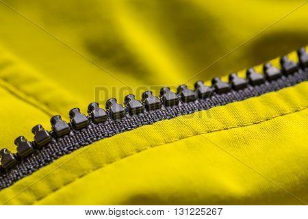 Zipper on clothes close up, studio shot