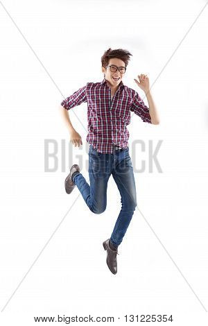 Young man in glasses running, isolated on white