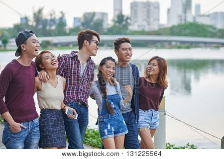Group of cheerful Vietnamese young people standing outdoors