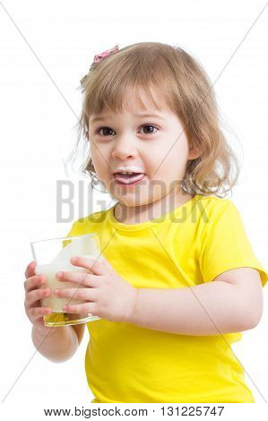 Adorable child girl drinking milk with milky mustache holding glass of milk