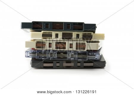 Bunch of 1970s cassette tape isolated on white.