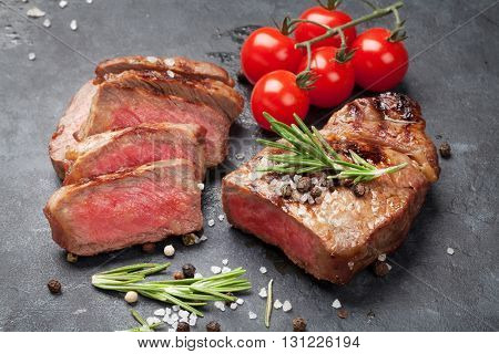 Grilled striploin sliced steak on stone table