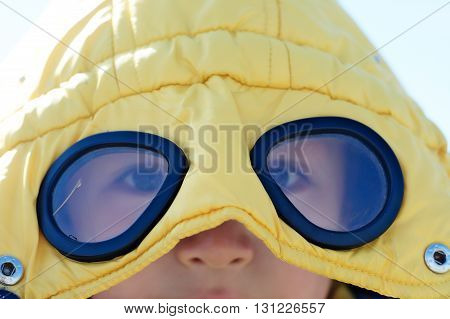 Boy In Yellow  Coat With Glasses Outside Closeup