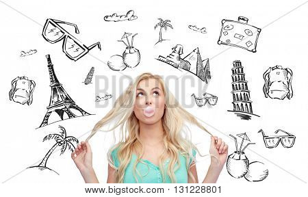 people, tourism, vacation and summer holidays concept - happy young woman or teenage girl chewing gum over touristic doodles