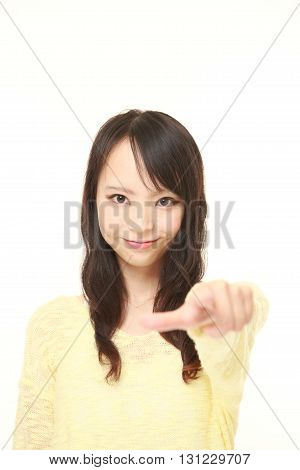portrait of young Japanese woman decided on white background