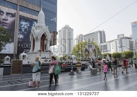 BANGKOK THAILAND - APR 17 : Unidentified people pray to Trimurati shrine at Central world in Ratchaprasong area on april 17 2016. Thailand. Trimurati shrine is one of sacred item in Ratchaprasong area