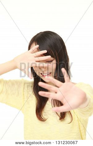 portrait of woman making stop gesture on white background