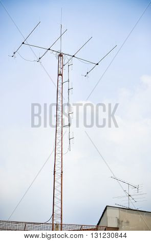 Old antenna for television with blue sky background