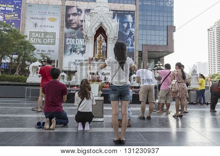 BANGKOK THAILAND - APR 17 : Unidentified tourist worship in Trimurati shrine at Central world in Ratchaprasong area on april 17 2016. Thailand. Trimurati shrine is one of sacred item in Ratchaprasong area