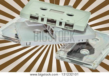 Audio cassette and tape on brown beam