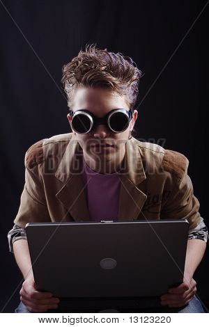 Portrait of a teens(hacker, student). Shot in studio.