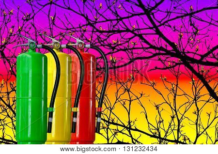 Many fire extinguisher tank on tree twings background