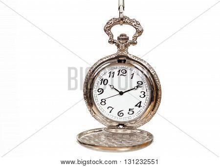 old vintage pocket watch on white background