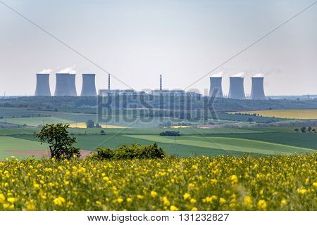Spring Landscape With Nuclear Power Plant On Horizon