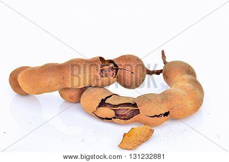 fresh Tamarind and insinde on white background