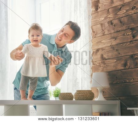 Happy loving family. Father and his daughter child girl playing together. Father's day concept.