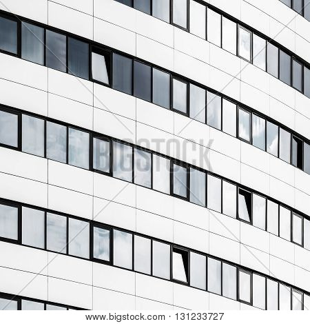 Close-up of modern office building. Facade of industrial building made of glass and steel. Modern industrial architecture.