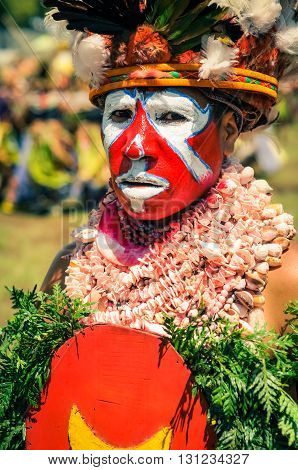 Woman With Stone Necklace In Papua New Guinea