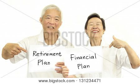 Happy Asian senior couple with sign retirment plan and financial plan