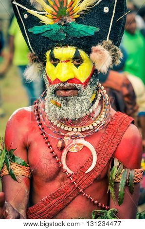 Man With Red Body In Papua New Guinea