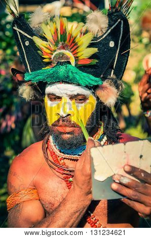 Man With Mirror In Papua New Guinea