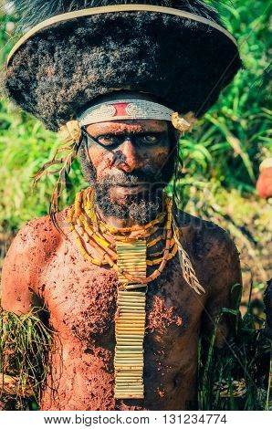 Posing Man With Headband In Papua New Guinea