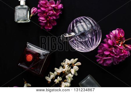 different perfume bottles in a black background