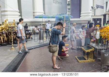 BANGKOK THAILAND - APR 17 : Unidentified tourist worship in Erawan shrine at Ratchaprasong Junction on april 17 2016 Thailand. Erawan shrine is one of famously sacred item in Ratchaprasong area