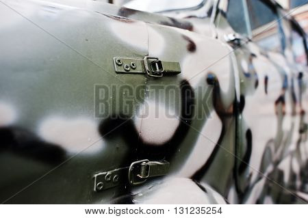 Detail on military camouflage green car jeep