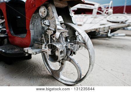Metal wheel disc at handmade red motorcycle