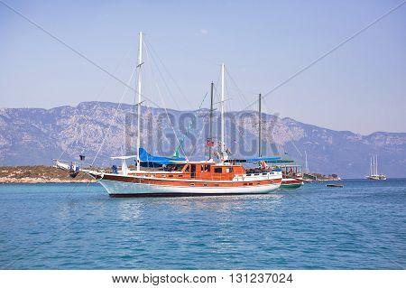 Sailing yachts anchored in calm bay. Aegean Sea, Turkey.