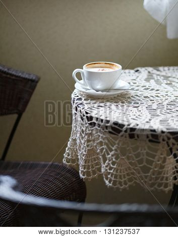 Cup Of Coffee On The Table In Cafe