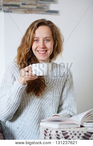 Smile Woman Holding Cup With Coffee Or Tea In Cafe