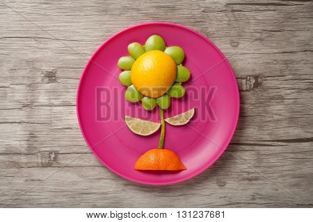 Fruit flower made on plate and plank