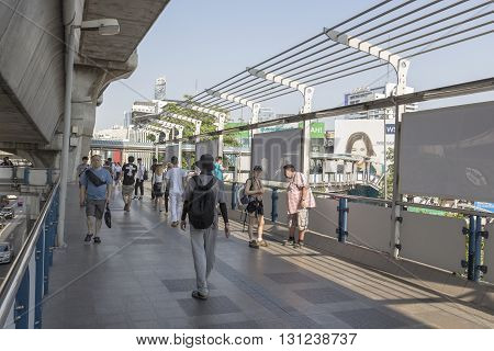 BANGKOK THAILAND - APR 24 : unidentified people on skywalk over Pathum Wan Junction near MBK center on april 24 2016 thailand. this skywalk link between BTS National Stadium station and Siam square