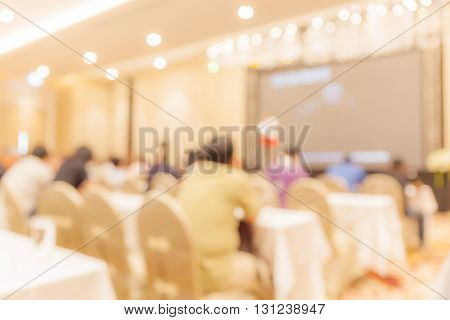Blurred people audience in conference event hall business concept.