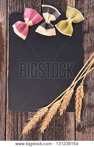 blackboard with wheat and pasta